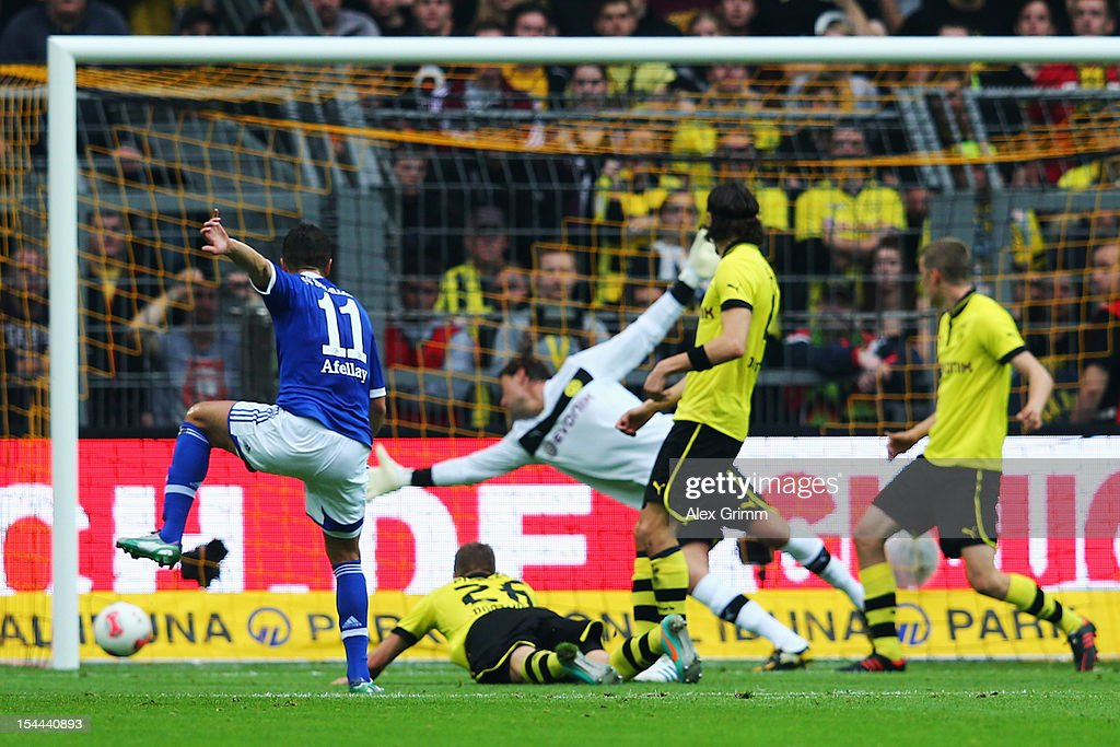Ibrahim Affelay (L) of Schalke scores his team's first goal during the Bundesliga match between Borussia Dortmund and FC Schalke 04 at Signal Iduna Park on October 20, 2012 in Dortmund, Germany.