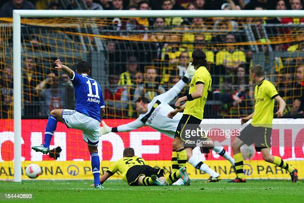 Ibrahim Affelay of Schalke scores his team's first goal during the Bundesliga match between Borussia Dortmund and FC Schalke 04 at Signal Iduna Park...