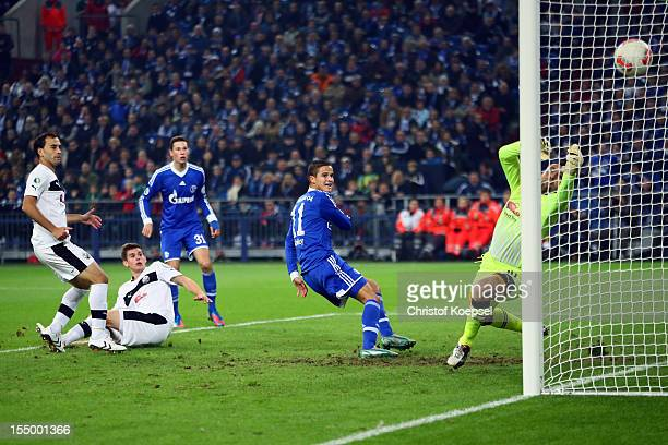 Ibrahim Affelay of Schalke scores the first goal against Daniel Ischdonat of Sandhausen during the DFB Cup second round match between FC Schalke 04...