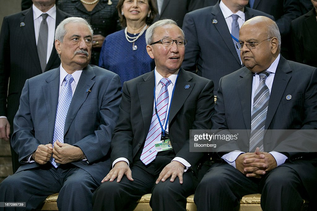 Ibrahim Al-Assaf, Saudi Arabia's finance minister, left to right, Hyun Oh Seok, South Korea' s finance minister, and Pravin Gordhan, South Africa's finance minister, attend an International Monetary Fund (IMF) governors group photograph during the IMF and World Bank Group Spring Meetings in Washington, D.C., U.S., on Saturday, April 20, 2013. The IMF's Managing Director said the euro area has the only central bank with enough leeway to take more measures to boost growth as low interest rates fail to trickle down to the region's economy. Photographer: Andrew Harrer/Bloomberg via Getty Images