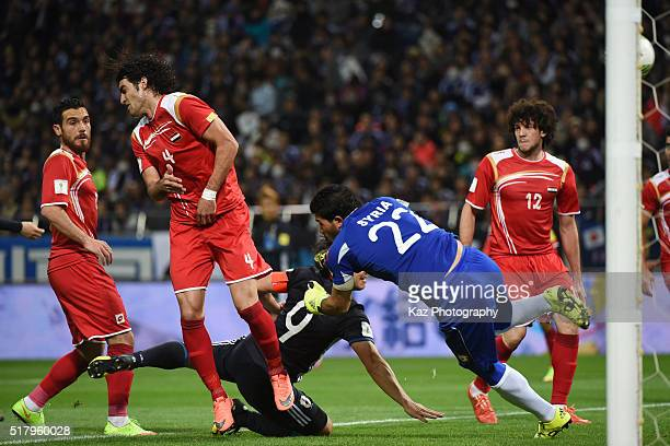 Ibrahim Almeh of Syria punches the ball deflected by Hamdi Al Massri resulting in an own goal during the FIFA World Cup Russia Asian Qualifier second...
