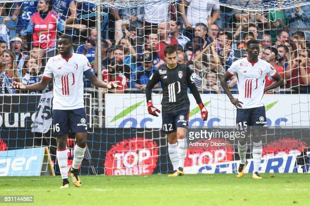 Ibrahim Amadou Nicolas De Preville and Edgar Ie of Lille looks dejected during the Ligue 1 match between Racing Club Strasbourg and Lille OSC at...