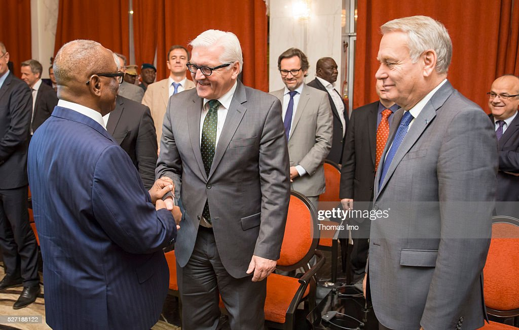 Ibrahim Boubacar Keita (L), President of Mali, welcomes German Foreign Minister Frank-Walter Steinmeier (C) on May 02, 2016 in Bamako, Mali. Steinmeier and Foreign Minister of France Marc Ayrault (R) visit Mali and Niger for political conversations.