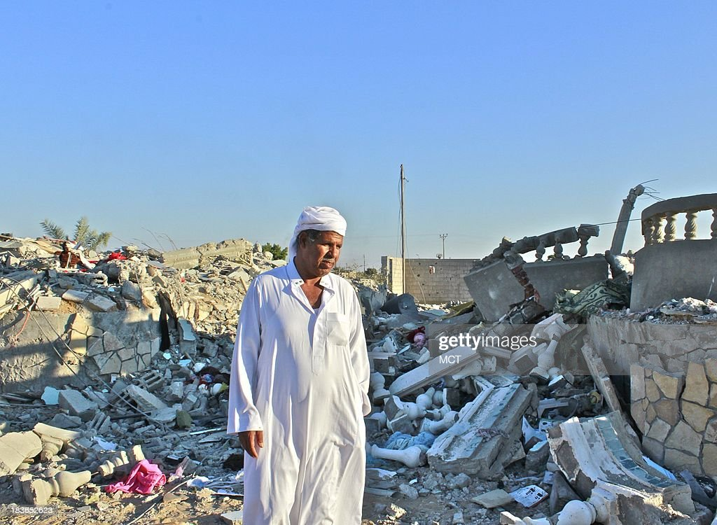 Ibrahim El-Menai, a powerful Bedouin leader from Al Sawarka tribe, stands in-between his son's and his own destroyed house, which had been demolished by Egyptian military last month along with many others in a vicious crackdown on militants in the vast lawless desert region that had always been a hideout to many militants in the region. Both houses are located almost 5km away from the Egyptian-Israeli boarder.