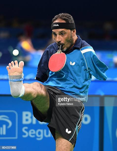 Ibrahim Hamadtou an armless Egyptian table tennis player tosses the ball using his right foot during a match against Britain's David Wetherill in the...