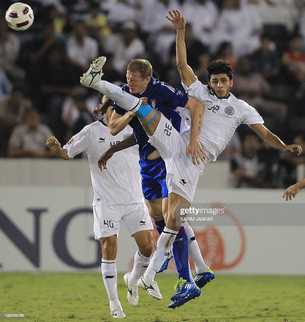 Ibrahim Maged of Qatar's Al-Sadd club (R) challenges Mato Neretljak of South Korea's Suwon Samsung Bluewings during their AFC Champions League semi-final football match at Al-Sadd stadium in Doha, on October 26, 2011. Suwon won 1-0.