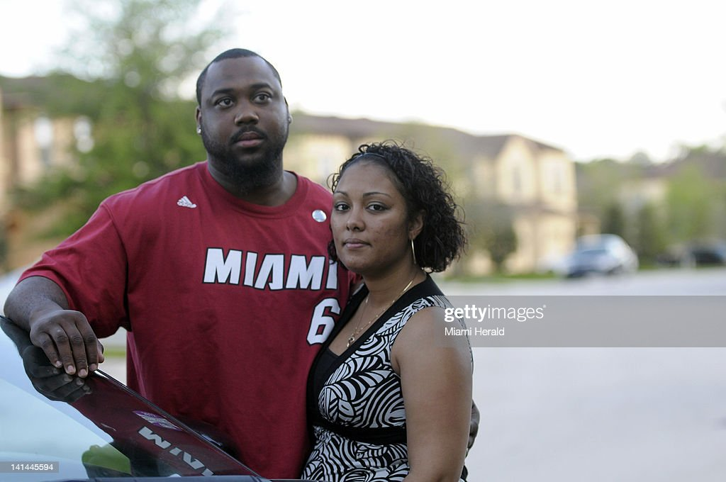 Ibrahim Rashada, left, and his wife Quianna stand in front of their home, March 15, 2012, in the neighborhood where Trayvon Martin was shot and killed in Sanford, Florida. Their home is situated where people cut through their gated community and several burglaries have occurred nearby.
