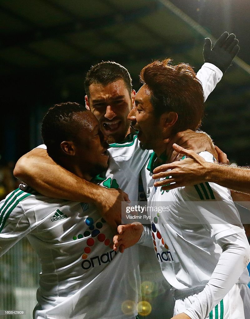 Ibrahim Sissoko (L) is celebrated by his team mates Giorgos Seitaridis (M) and Yohei Kajiyama after scoring his team's first goal during the Superleague match between Asteras Tripolis and Panathinaikos FC at Asteras Tripolis Stadium on February 2, 2013 in Tripolis, Greece.
