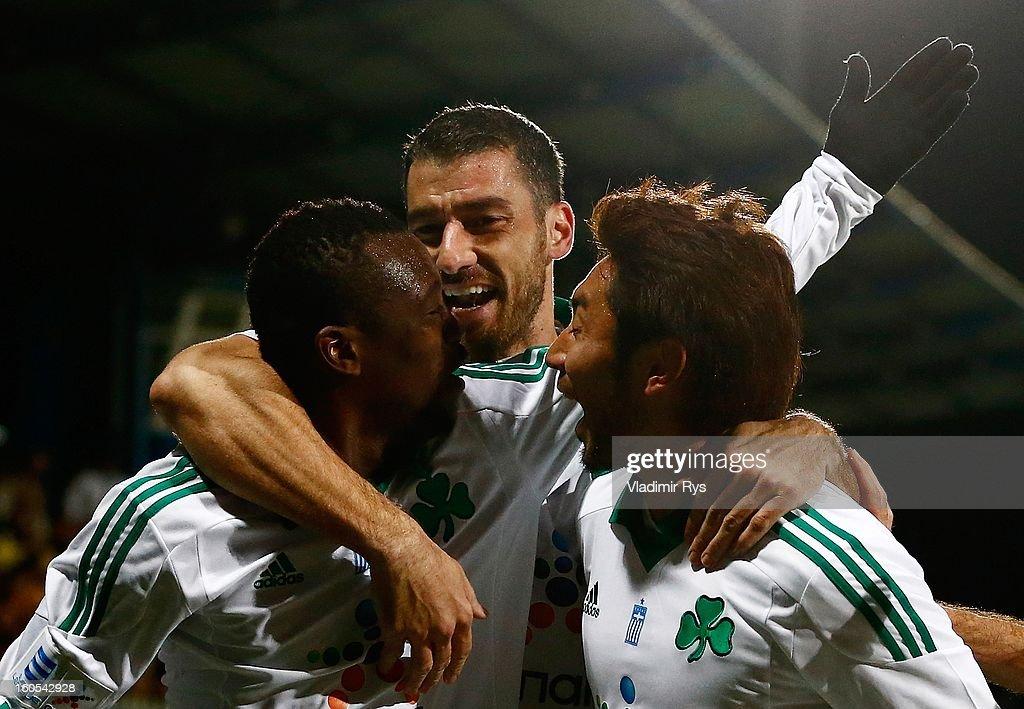 Ibrahim Sissoko is celebrated by his team mates Giorgos Seitaridis and Yohei Kajiyama after scoring his team's first goal during the Superleague...