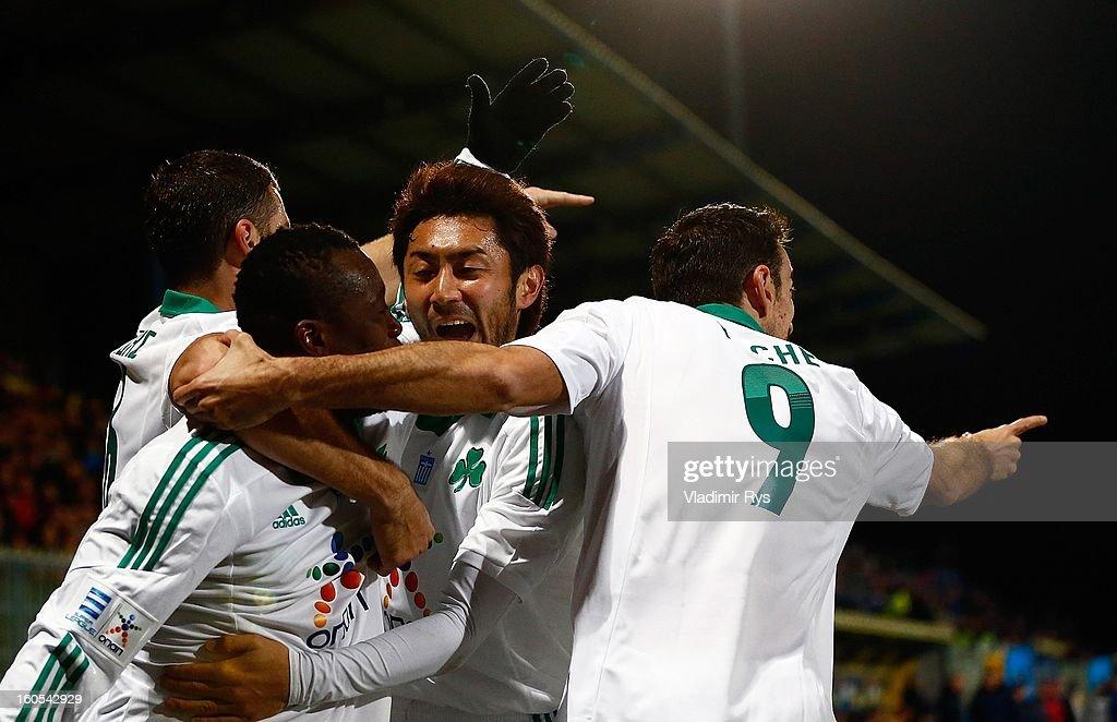Ibrahim Sissoko is celebrated by his team mates Giorgos Seitaridis Yohei Kajiyama and Toche of Panathinaikos after scoring his team's first goal...