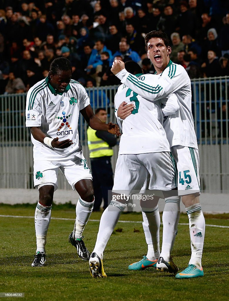 Ibrahim Sissoko (C) is congratulated by his team mates Pape Habib Sow (L) and Konstantinos Triantafyllopoulos of Panathinaikos after scoring his team's second goal during the Superleague match between Asteras Tripolis and Panathinaikos FC at Asteras Tripolis Stadium on February 2, 2013 in Tripolis, Greece.