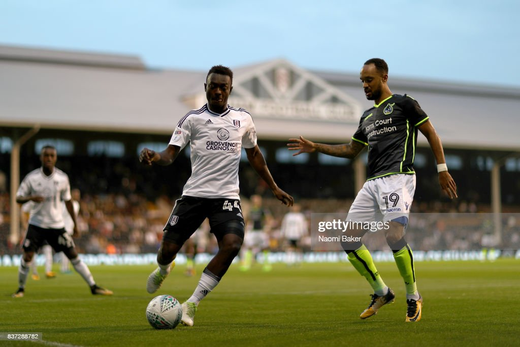 Ibrahima Cisse of Fulham holds off Byron Moore of Bristol Rovers during the Carabao Cup Second Round match between Fulham and Bristol Rovers at Craven Cottage on August 22, 2017 in London, England.