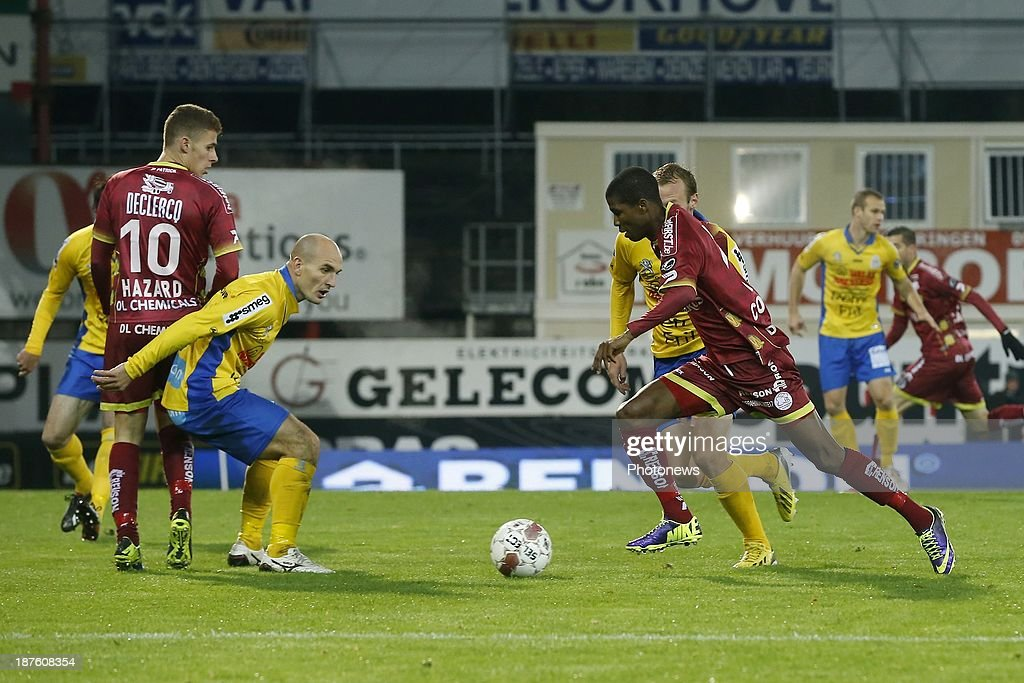 Ibrahima Conte of Zulte Waregem and Milos Maric of Waasland Beveren during the Jupiler Pro League match between Zulte Waregem and Waasland Beveren on November 10, 2013 in Waregem, Belgium.