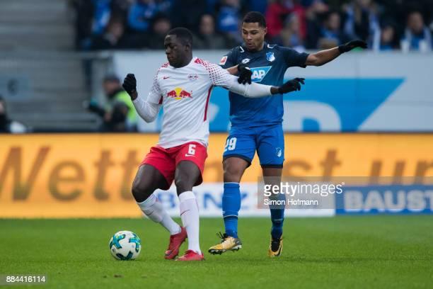 Ibrahima Konate of Leipzig is challenged by Serge Gnabry of Hoffenheim during the Bundesliga match between TSG 1899 Hoffenheim and RB Leipzig at...