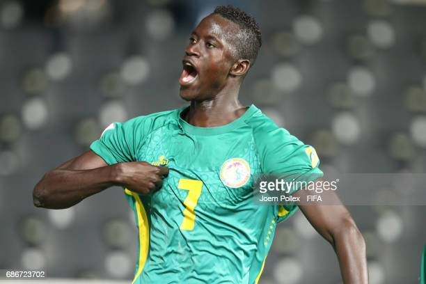 Ibrahima Niane of Senegal celebrates with his team mates after scoring his team's first goal of Senegal compete for the ball during the FIFA U20...