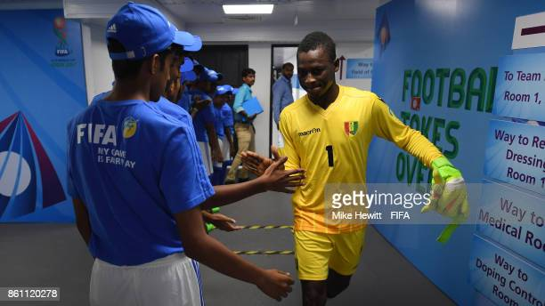 Ibrahima Sylla of Guinea high fives the volunteers ahead of the FIFA U17 World Cup India 2017 group C match between Guinea and Germany at Jawaharlal...