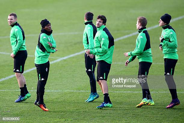 Ibrahima Traore and Marvin Schulz attend a taining session ahead of the UEFA Champions League match between Borussia Moenchengladbach and Manchester...
