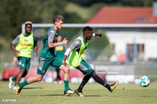 Ibrahima Traore is chased by Michael Cuisance during a training session at the Training Camp of Borussia Moenchengladbach on July 19 2017 in...