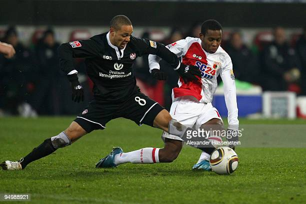 Ibrahima Traore of Augsburg battles for the ball with Sidney Sam of Kaiserslautern during the Second Bundesliga match between FC Augsburg and 1 FC...