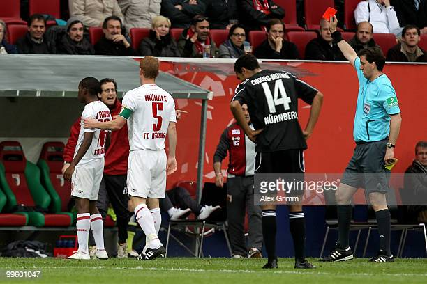 Ibrahima Traore of Augsburg is sent off by referee Manuel Graefe during the Bundesliga play off leg two match between FC Augsburg and 1 FC Nuernberg...
