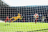 Ibrahima Traore of Borussia Moenchengladbach shoots and scores the third goal of the game past goalkeeper Bernd Leno of Leverkusen during the...