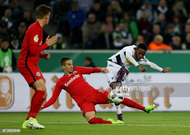 Ibrahima Traore of Moenchengladbach and Mijat Gacinovic of Frankfurt battle for the ball during the DFB Cup semi final match between Borussia...