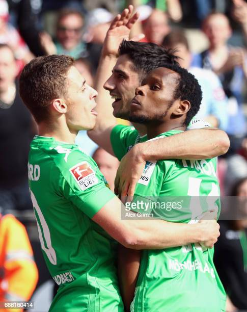 Ibrahima Traore of Moenchengladbach celebrates his team's second goal with team mates Thorgan Hazard and Lars Stindl during the Bundesliga match...