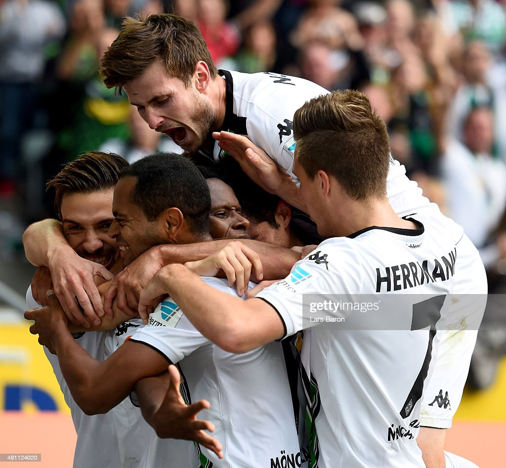<a gi-track='captionPersonalityLinkClicked' href=/galleries/search?phrase=Ibrahima+Traore&family=editorial&specificpeople=4380349 ng-click='$event.stopPropagation()'>Ibrahima Traore</a> of Moenchengladbach celebrates with Havard Nordtveit and other team mates after scoring his teams second goal during the Bundesliga match between Borussia Moenchengladbach and VfL Wolfsburg at Borussia-Park on October 3, 2015 in Moenchengladbach, Germany.