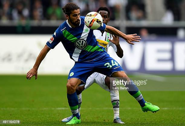 Ibrahima Traore of Moenchengladbach challenges Ricardo Rodriguez of Wolfsburg during the Bundesliga match between Borussia Moenchengladbach and VfL...