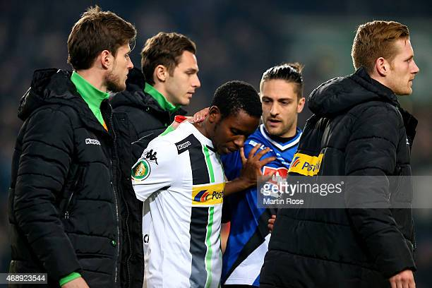 Ibrahima Traore of Moenchengladbach looks dejected after penalty shoot out during the DFB Cup Quarter Final match between Arminia Bielefeld and...