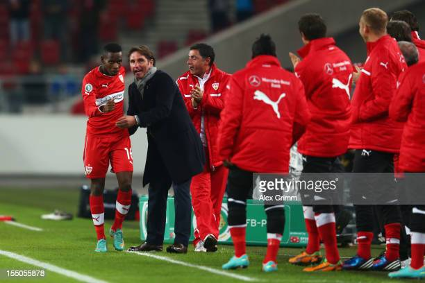 Ibrahima Traore of Stuttgart celebrates his team's first goal with head coach Bruno Labbadia during the second round match of the DFB Cup between VfB...