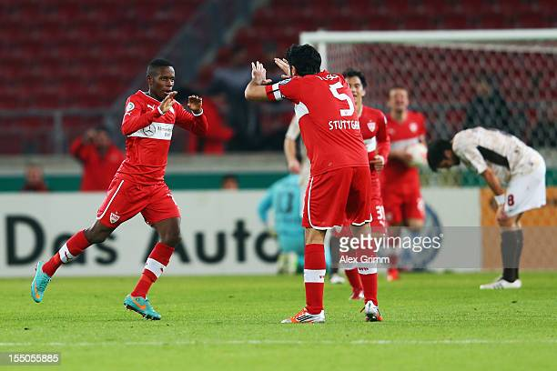Ibrahima Traore of Stuttgart celebrates his team's first goal with team mate Serdar Tasci during the second round match of the DFB Cup between VfB...