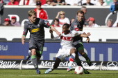 Ibrahima Traore of Stuttgart fights for the ball with Thorben Marx and Tony Janitschke Moenchengladbach during the Bundesliga match between VfB...
