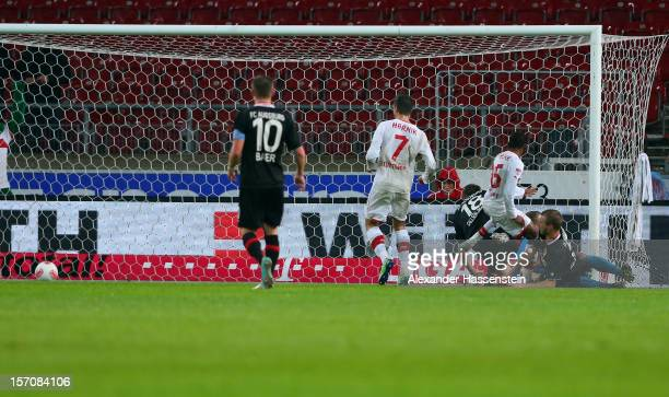 Ibrahima Traore of Stuttgart scores the opening goal with his team mates during the Bundesliga match between VfB Stuttgart and FC Augsburg at...