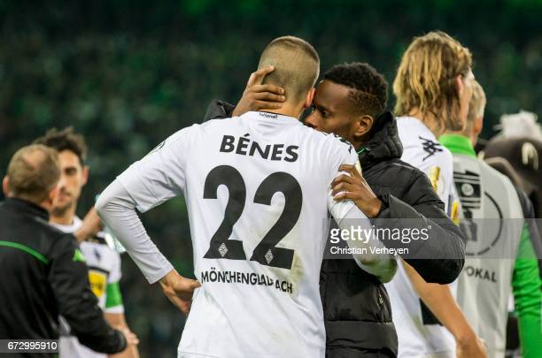 Ibrahima Traore talks to Laszlo Benes of Borussia Moenchengladbach before the extra time started during the DFB Cup Semi Final between Borussia...