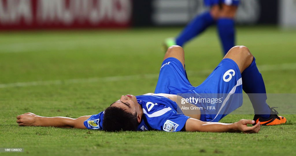 Ibrokhim Abdullaev of Uzbekistan reacts after Jorge Bodden of Honduras scored his team's first goal during the FIFA U-17 World Cup UAE 2013 Round of 16 match between Honduras and Uzbekistan at Sharjah Stadium on October 28, 2013 in Sharjah, United Arab Emirates.