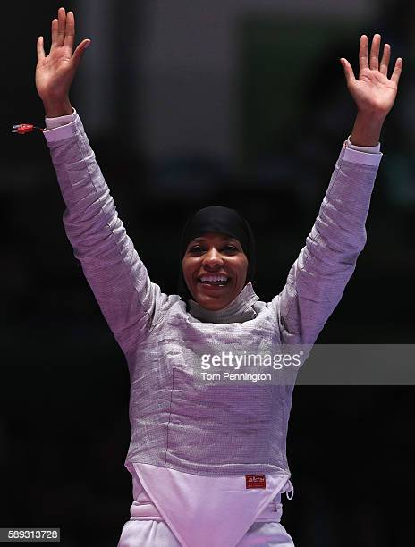 Ibtihaj Muhammad of the United States celebrates after the United States wins the Women's Sabre Team bronze medal match between United States and...