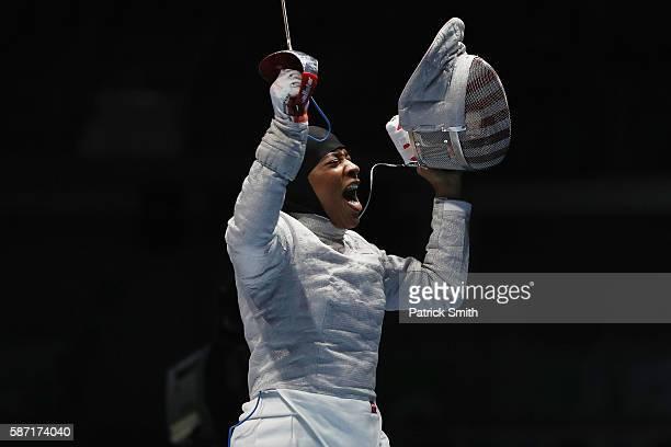 Ibtihaj Muhammad of the United States celebrates victory over Olena Kravatska of Ukraine during the Women's Individual Sabre on Day 3 of the Rio 2016...