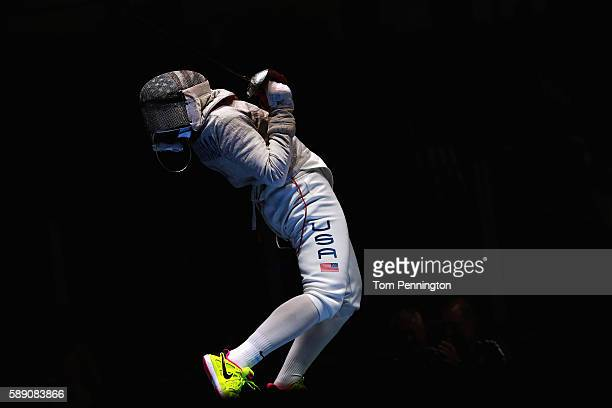 Ibtihaj Muhammad of the United States reacts against Sofya Velikaya of Russia during the Women's Sabre Team Semifinal 1 Russia vs United States at...