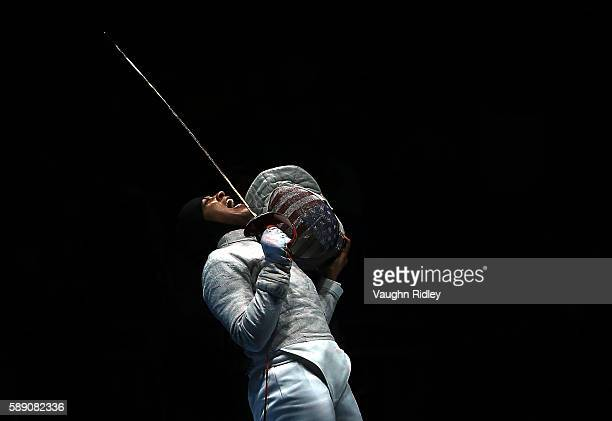 Ibtihaj Muhammad of the USA celebrates a point over Ekaterina Dyachenko of Russia in the Women's Sabre Team Semifinals on Day 8 of the Rio 2016...