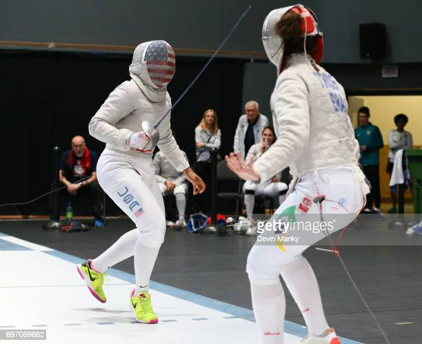 Ibtihaj Muhammad of the USA fences Karina Trois of team Brazil during the Team Women's Sabre event on June 17 2017 at the PanAmerican Fencing...