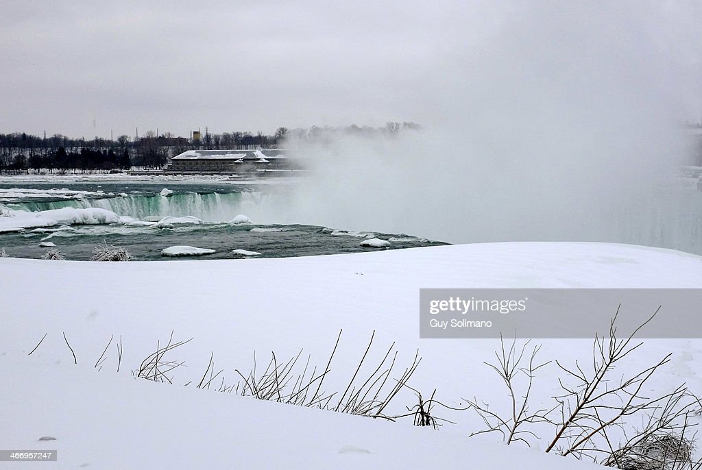 Ice and snow cover the Canadian Horseshoe Falls, part of Niagara Falls, from the American side on February 5, 2014 in Niagara Falls, New York. An additional foot of snow blanketed Western New York overnight in the latest winter storm system that has affected areas from Kansas to Maine..