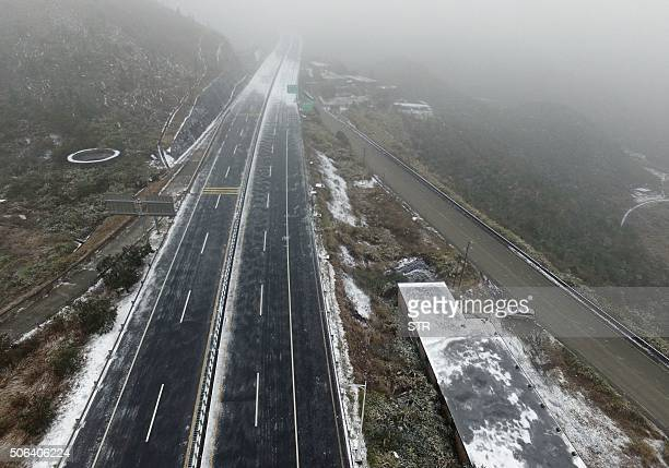 Ice and snow covers a highway closed during the cold snap in Shaoguan south China's Guangdong province on January 23 2016 Much of China shivered on...