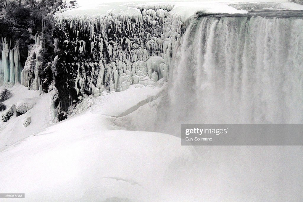 Ice and snow forms on the Niagara River in front of Niagara Falls on February 5, 2014 in Niagara Falls, New York. An additional foot of snow blanketed Western New York overnight in the latest winter storm system that has affected areas from Kansas to Maine..