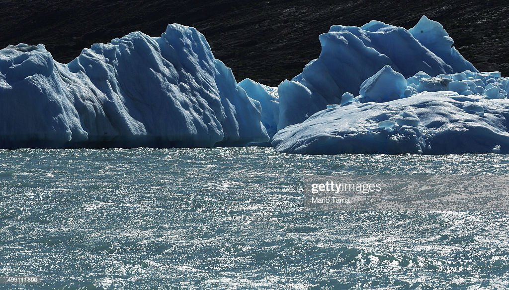 Ice broken off from a melting glacier floats in Lake Argentino, which holds runoff water from the Southern Patagonian Ice Field, the third largest ice field in the world, on November 28, 2015 in Santa Cruz Province, Argentina. Certain areas of glacial ice take on a blueish hue due to light refraction. The majority of the almost fifty large glaciers in the surrounding Los Glaciares National Park have been retreating over the past fifty years due to warming temperatures, according to the European Space Agency (ESA). The United States Geological Survey reports that over 68 percent of the world's freshwater supplies are locked in icecaps and glaciers. The United Nations climate change conference begins November 30 in Paris.
