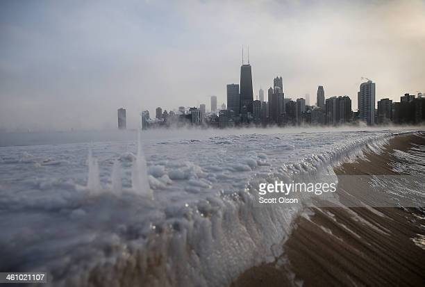 Ice builds up along Lake Michigan at North Avenue Beach as temperatures dipped well below zero on January 6 2014 in Chicago Illinois Chicago hit a...