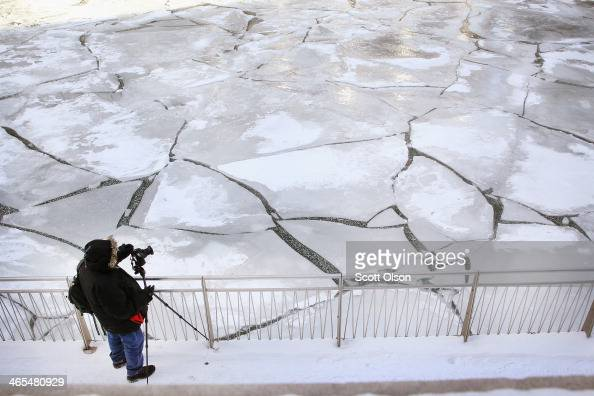 Ice builds up on the Chicago River as temperatures drop below zero January 27 2014 in Chicago Illinois The city is bracing for another round of...