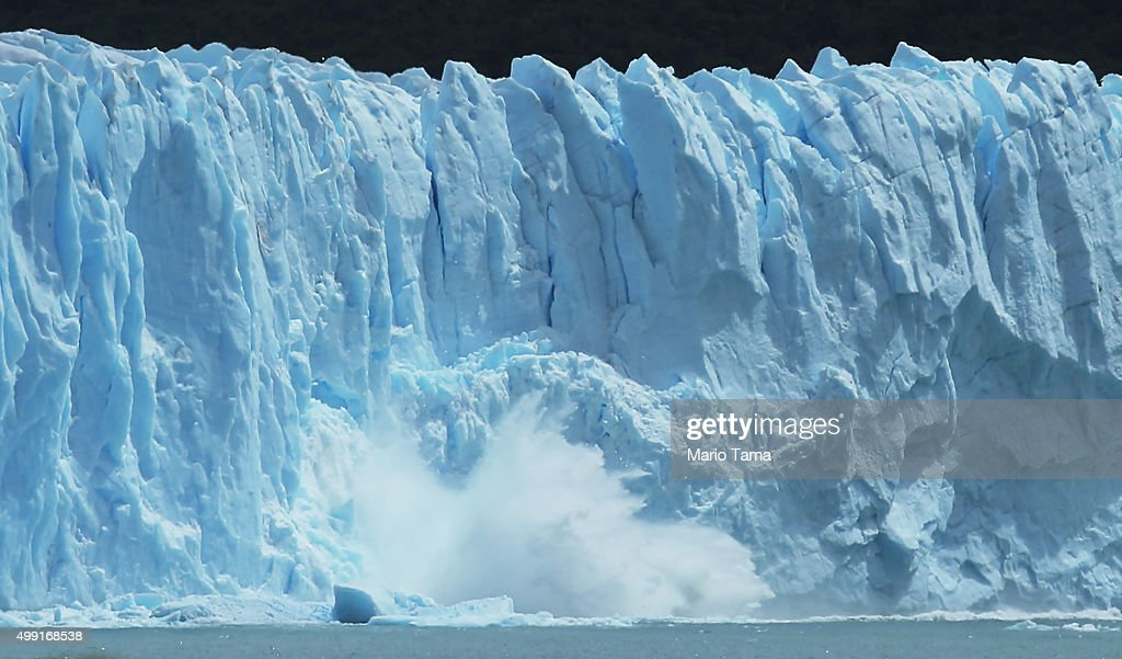 Ice calves from the Northern wall of the Perito Moreno glacier in Los Glaciares National Park, part of the Southern Patagonian Ice Field, on November 29, 2015 in Santa Cruz Province, Argentina. Certain areas of glacial ice take on a bluish hue due to light refraction. The Southern Patagonian Ice Field is the third largest ice field in the world. The majority of the almost 50 large glaciers in Los Glaciares National Park have been retreating during the past fifty years due to warming temperatures, according to the European Space Agency (ESA). The United States Geological Survey (USGS) reports that over 68 percent of the world's freshwater supplies are locked in ice caps and glaciers. The United Nations climate change conference begins November 30 in Paris.