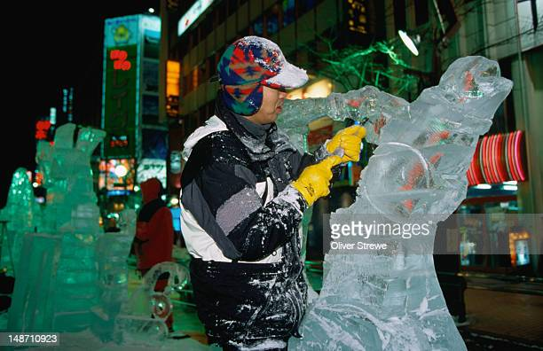 Ice carver preparing for the Sapporo Yuki Matsuri (snow festival where hundreds of visitors come to admire the amazing ice sculptures and carvings