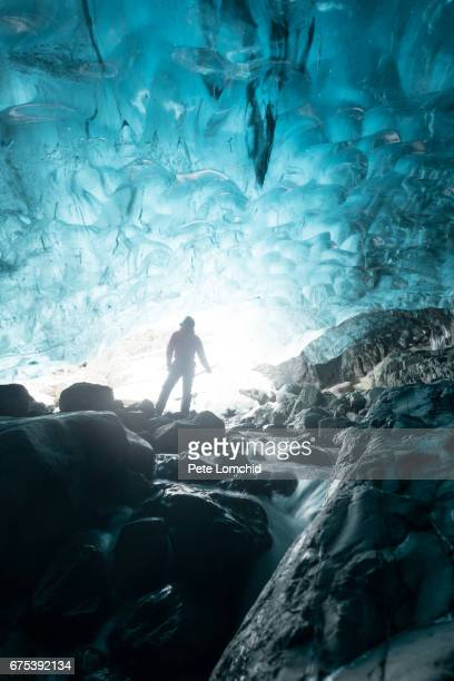 Ice cave explorer, winter Iceland
